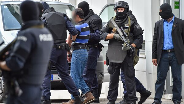 A suspected member of the Islamic State jihadist group is led away by Austrian police from the court in Linz, Austria, on July 27, 2016 - Sputnik International