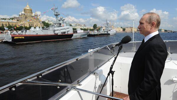 Russian President Vladimir Putin on the Serafim Sarovsky boat during a parade of ships held to celebrate the Navy Day in St. Petersburg - Sputnik International