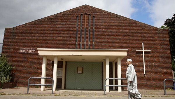 A Muslim who walks past the church Sainte Therese in Saint-Etienne-du-Rouvray near Rouen in Normandy, France, July 27, 2016. - Sputnik International