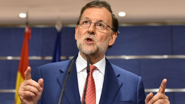 Spain's interim Prime Minister Mariano Rajoy gives a press conference at the Spanish parliament in Madrid - Sputnik International