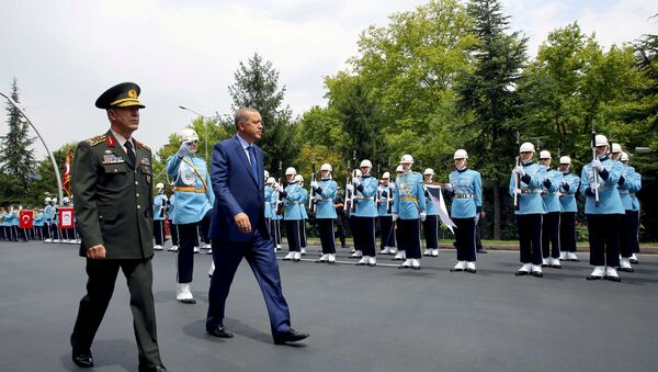 Turkey's President Tayyip Erdogan reviews a guard of honour as he is accompanied by Chief of Staff General Hulusi Akar upon his arrival to the Chief of Staff Headquarters in Ankara, Turkey, August 3, 2016. - Sputnik International