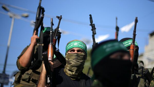 Hamas militants hold weapons as they celebrate the release of Palestinian prisoner Mohammed al-Bashiti, who served 12 years in an Israeli jail after he was convicted of being a member of Hamas' armed wing, in Rafah in the southern Gaza Strip July 25, 2016 - Sputnik International