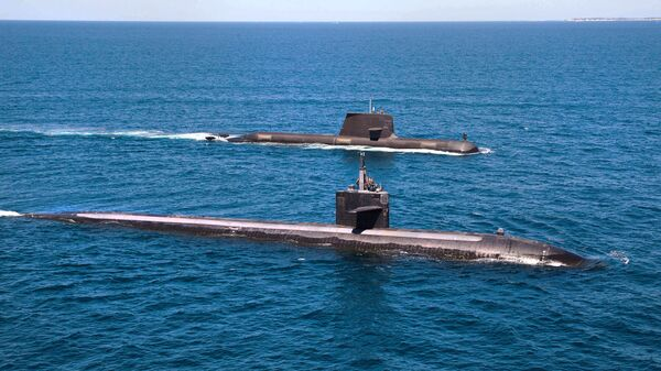 The U.S. Navy's Los Angeles-class fast attack submarine USS Albuquerque (SSN 706) and Royal Australian Navy Collins-class submarine HMAS Rankin (SSG 78) operate together in waters off Rottnest Island, Western Australia. - Sputnik International