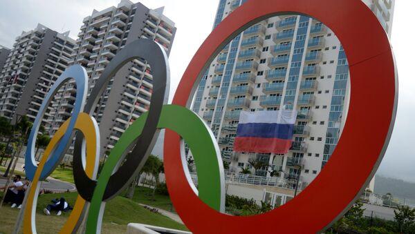 A Russian flag at the Olympic village in Rio de Janeiro - Sputnik International