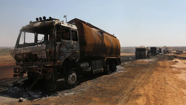Damaged trucks are pictured after an airstrike on a truck parking lot in the rebel-held town of Atareb in Aleppo province, Syria August 3, 2016 - Sputnik International