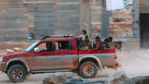 Fighters of the Syrian Islamist rebel group Jabhat Fateh al-Sham, the former al Qaeda-affiliated Nusra Front, ride on a pick-up truck in the 1070 Apartment Project area in southwestern Aleppo, Syria August 5, 2016 - Sputnik International