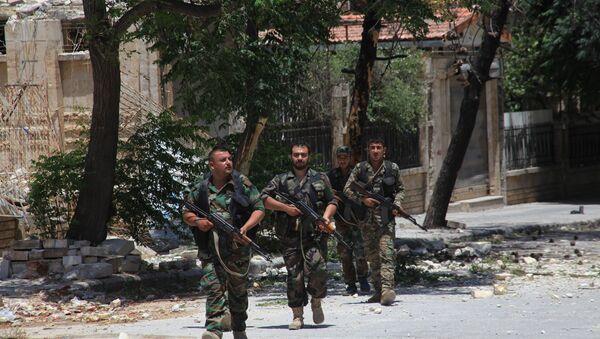 Syrian army soldiers patrol a street in government-controlled Aleppo's al-Khalidiya area (File) - Sputnik International