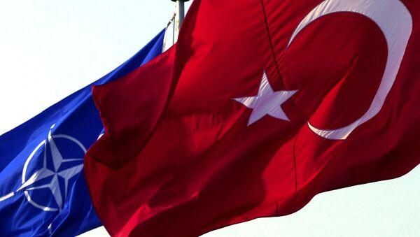 A Turkish flag waves in front of NATO's one - Sputnik International