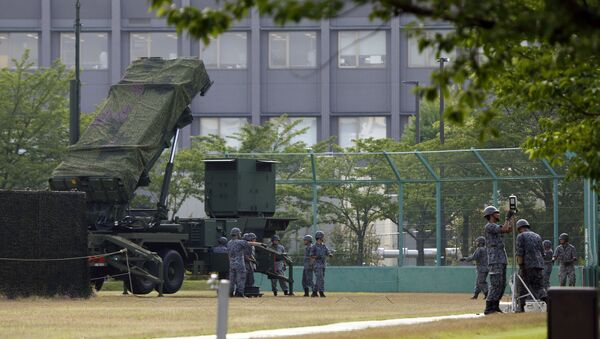 Japan Self-Defense Force members set up a PAC-3 Patriot missile unit in case of a North Korean rocket launch at the Defense Ministry in Tokyo, Tuesday, June 21, 2016 - Sputnik International