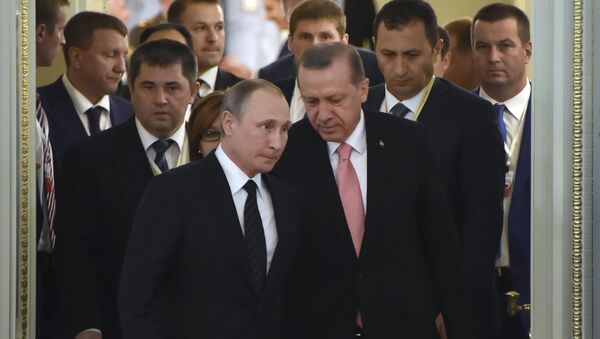 Russian President Vladimir Putin (C-L) and his Turkish counterpart Recep Tayyip Erdogan (C-R) enter a hall to start their meeting with Russian and Turkish entrepreneurs in Konstantinovsky Palace outside Saint Petersburg on August 9, 2016 - Sputnik International