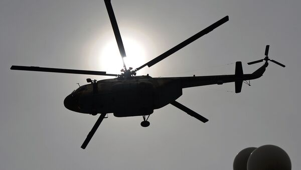 This file photo taken on March 23, 2014 shows a Pakistani Air Force Mi-17 helicopter flies over the Presidential Palace during a parade marking the country's National Day in Islamabad - Sputnik International