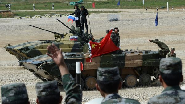 China's BMP-2 crew which took a second place the final contest of the Suvorovsky Natisk (Suvorov Onslaught) competition at the Alabino training ground in the Moscow Region. Background: Russia's BMP-2 crew which won the final contest of the Suvorovsky Natisk (Suvorov Onslaught) competition at the Alabino training ground in the Moscow Region - Sputnik International