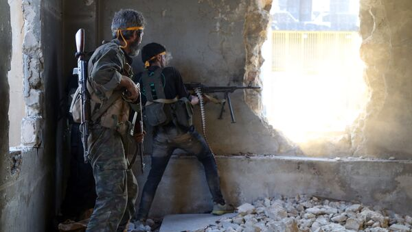 Rebel fighters fire towards positions of regime forces in Ramussa on the southwestern edges of Syria's northern city of Aleppo on August 6, 2016 - Sputnik International