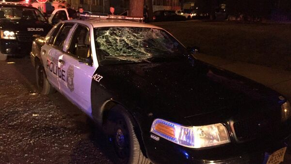 A police car with broken windows is seen in a photograph released by the Milwaukee Police Department after disturbances following the police shooting of a man in Milwaukee, Wisconsin, U.S. August 13, 2016 - Sputnik International