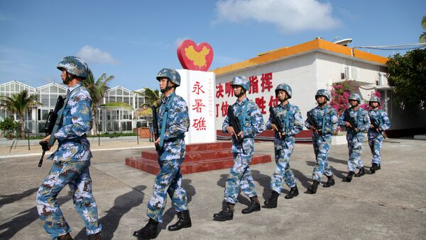 Soldiers of China's People's Liberation Army (PLA) Navy patrol at Fiery Cross Reef, in the Spratly Islands, known in China as the Nansha Islands (File) - Sputnik International