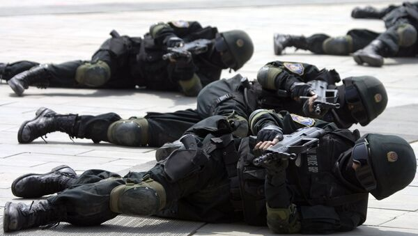 Special police forces demonstrate their craft during a drill to mark the launch of a training program on Beijing Olympic Games security held at the Beijing People's Police Institute on the outskirts of Beijing, China. file photo - Sputnik International
