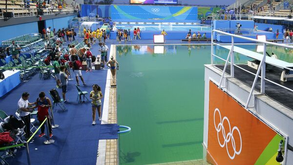 A general view shows the green water in the pool before the Women's Synchronised 10m Platform Final as part of the diving event at the Rio 2016 Olympic Games at the Maria Lenk Aquatics Stadium in Rio de Janeiro - Sputnik International