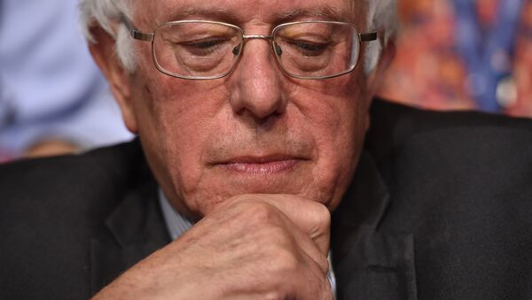 Senator Bernie Sanders looks on after the Vermont delegation cast their votes during roll call on the second day of the Democratic National Convention at the Wells Fargo Center, July 26, 2016 - Sputnik International