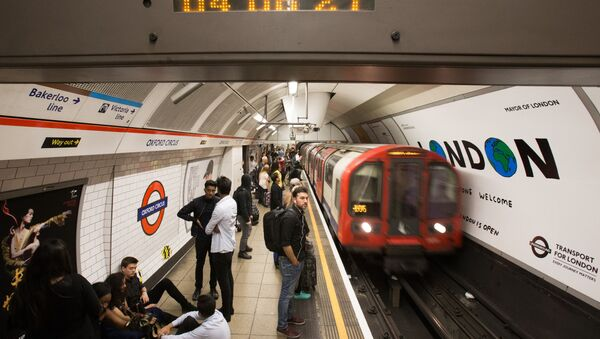 A London Underground train arrives at Oxford Circus station in central London on August 20, 2016, following the launch of the 24 hour night tube service - Sputnik International