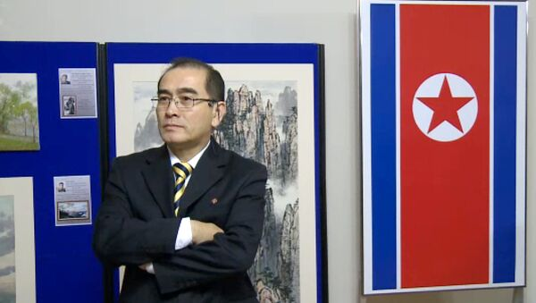 In a video grab created on August 17, 2016 taken from footage recorded by AFPTV on November 3, 2014 deputy ambassador at the North Korean embassy in London, Thae Yong-ho, stands in front of an artwork during a photocall to view an exhibition of North Korean art at the North Korean embassy in west London - Sputnik International