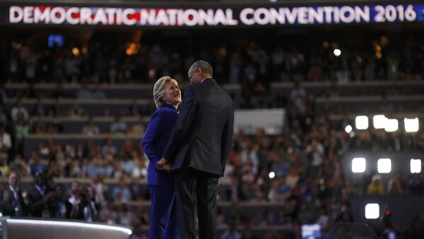 U.S. President Barack Obama and Democratic presidential nominee Hillary Clinton appear onstage together after his speech on the third night at the Democratic National Convention in Philadelphia, Pennsylvania, U.S. July 27, 2016 - Sputnik International