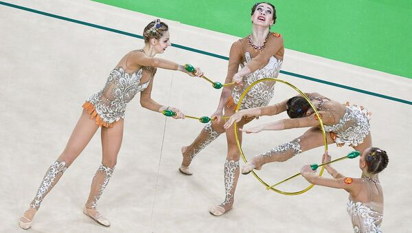 The Russian national team on Sunday won a gold medal at the women's rhythmic gymnastics all-around competition at the ongoing Olympic Games in Rio de Janeiro. - Sputnik International