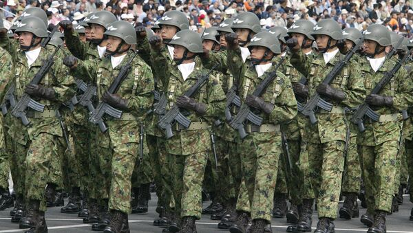 Troops of Japan Grand Self-Defense Force (JGSDF) 1st Airborne Brigade march during an inspection parade for the JGSDF Eastern Army 44th anniversary celebration at Asaka training field, suburban Tokyo (File) - Sputnik International