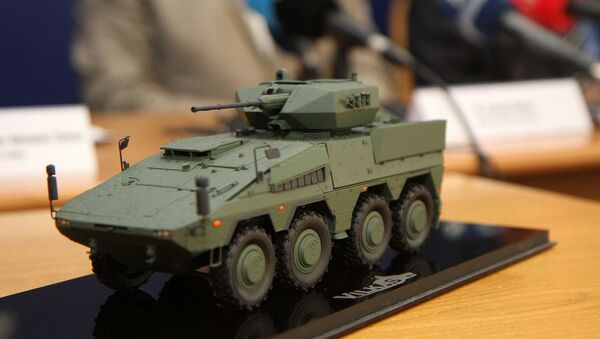 A model of the Boxer infantry fighting vehicles (IFV) is pictured during a press conference at the Ministry of National Defence in Vilnius, Lithuania, on August 22, 2016 - Sputnik International
