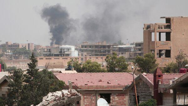 Smoke rises from the northeastern city of Hasaka, Syria, August 21, 2016 - Sputnik International