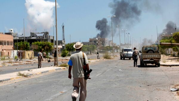 Smoke rises during a battle between Libyan forces allied with the U.N.-backed government and Islamic State fighters in neighborhood Number Two in Sirte, Libya August 16, 2016 - Sputnik International