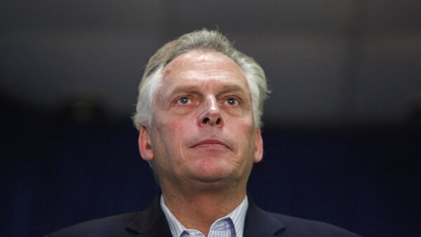 Democratic nominee for Virginia governor Terry McAuliffe stands onstage during a campaign rally in Dale City, Virginia, October 27, 2013 - Sputnik International