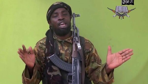 May 12, 2014 file photo taken from video by Nigeria's Boko Haram terrorist network, and shows their leader Abubakar Shekau speaking to the camera - Sputnik International