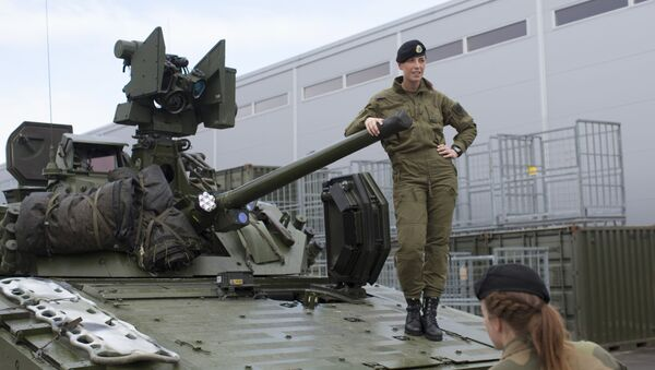 Female soldiers talk next to a CV90 combat vehicle at the armored battalion in Setermoen, northern Norway on August 11, 2016. Norway has become the first NATO member to have compulsory conscription for women as well as men in the army. Recently, the first batch of army recruits joined the ranks in The Armored Battalion in the Norwegian Army located in Setermoen in northern Norway. - Sputnik International