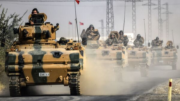 This picture taken around 5 kilometres west from the Turkish Syrian border city of Karkamis in the southern region of Gaziantep, on August 25, 2016 shows Turkish Army tanks driving to the Syrian Turkish border town of Jarabulus. - Sputnik International