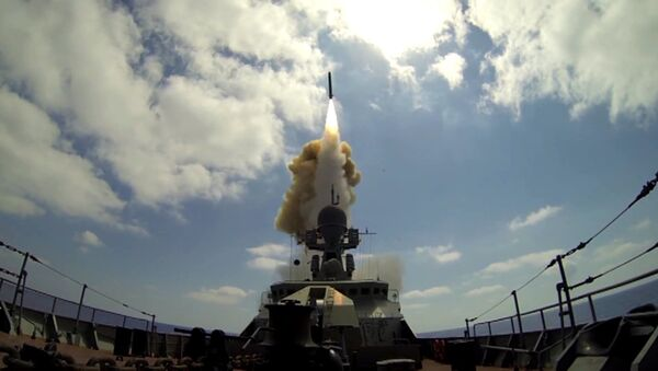 A Russian Navy ship launches a Kalibr cruise missile at the Jabhat Al-Nusra terrorist groupfrom the Mediterranean Sea. File photo - Sputnik International