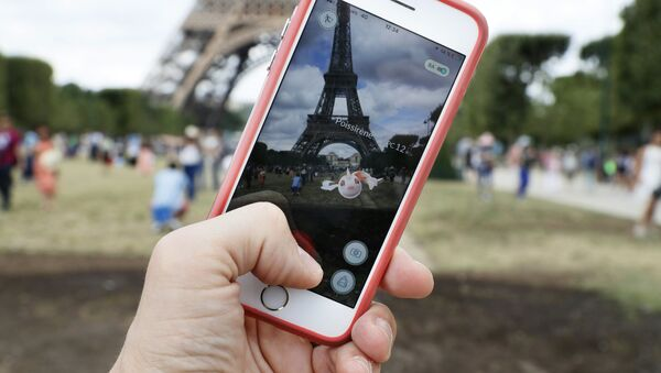 This file photo taken on July 26, 2016 shows the 'Pokemon Go' app on the screen of a smartphone, in Paris, on July 26, 2016 - Sputnik International
