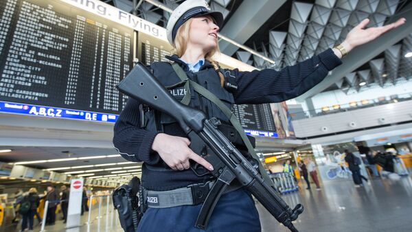 An armed policewoman gestures in Frankfurt Airport, on March 22, 2016, in Frankfurt, western Germany - Sputnik International