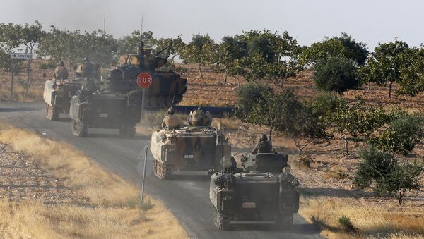Turkish armoured personnel carriers drive towards the border in Karkamis on the Turkish-Syrian border in the southeastern Gaziantep province, Turkey, August 27, 2016 - Sputnik International