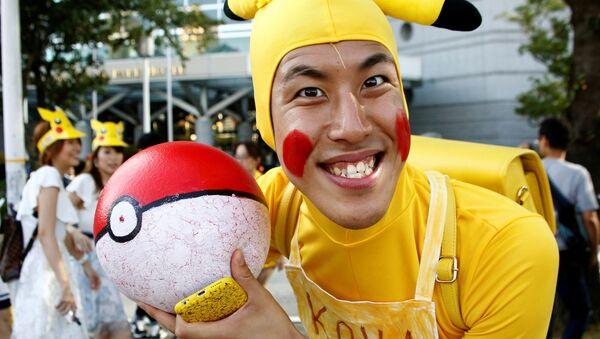 A man wearing Pokemon's character Pikachu costume - Sputnik International