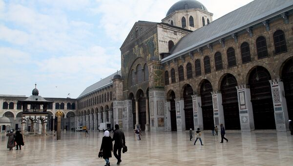 Syrian Muslims walk in the courtyard of the historic Umayyad Mosque before weekly prayers in Damascus, Syria. File photo - Sputnik International