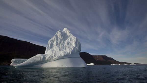 Iceberg floats in the sea near Qeqertarsuaq, Disko Island, Greenland - Sputnik International