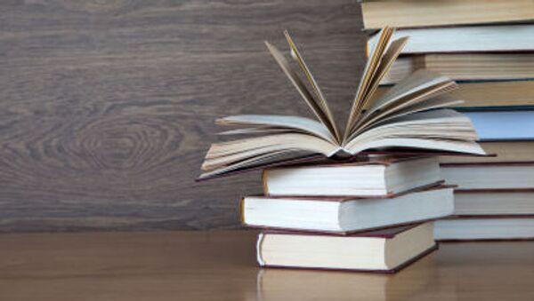 Books on wooden deck tabletop. - Sputnik International