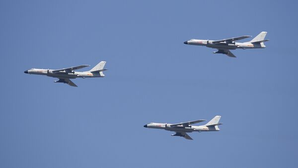 H-6K cruise missile carriers fly in formation during a parade - Sputnik International