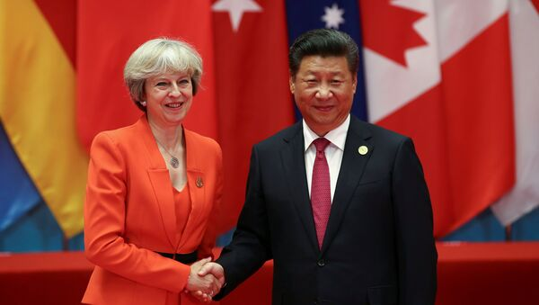 Chinese President Xi Jinping (R) shakes hands with Britain's Prime Minister Theresa May during the G20 Summit in Hangzhou, Zhejiang province, China September 4, 2016. - Sputnik International