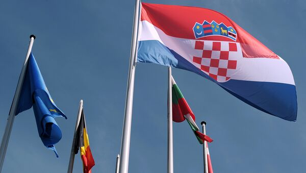 Croatian flag is raised during a ceremony for Croatia's accession to the European Union on July 01, 2013, in the European Parliament in Strasbourg, eastern France - Sputnik International