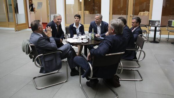 AfD (Alternative for Germany) party chairwoman, Frauke Petry, center, talks with party members prior to a news conference in Berlin, Monday, Sept. 5, 2016 - Sputnik International
