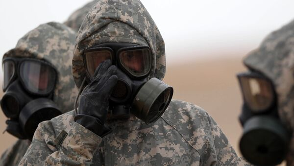 Soldiers wear mask sas they take part in a military exercise simulating a chemical weapons attack during the international Eager Lion military event on June 2, 2014 at Prince Hashem Bin Abdullah II training center, in Zarqa, 30 km east of Amman, Jordan - Sputnik International
