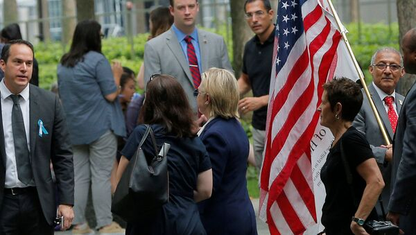 US Democratic presidential candidate Hillary Clinton leaves ceremonies marking the 15th anniversary of the September 11 attacks at the National 9/11 Memorial in New York, New York, United States September 11, 2016. - Sputnik International