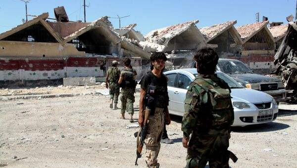 Syrian Army troops in the Ramouseh district of southern Aleppo. - Sputnik International