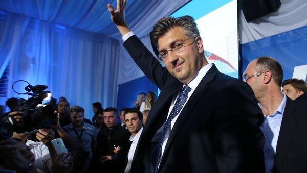 Andrej Plenkovic, president of the Croatian Democratic Union (HDZ), reacts during a speech after exit polls in Zagreb, Croatia, September 11, 2016 - Sputnik International